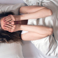 Photo of Woman having insomnia in bed